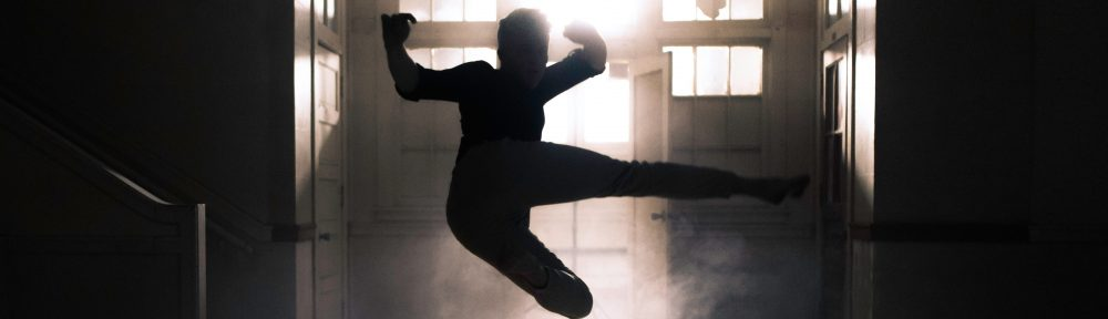 """Silhouette of a person doing a jump kick to represent """"kickass social media consultant"""""""